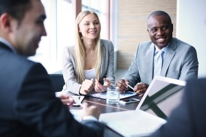 Image of business people listening and talking to their colleagu