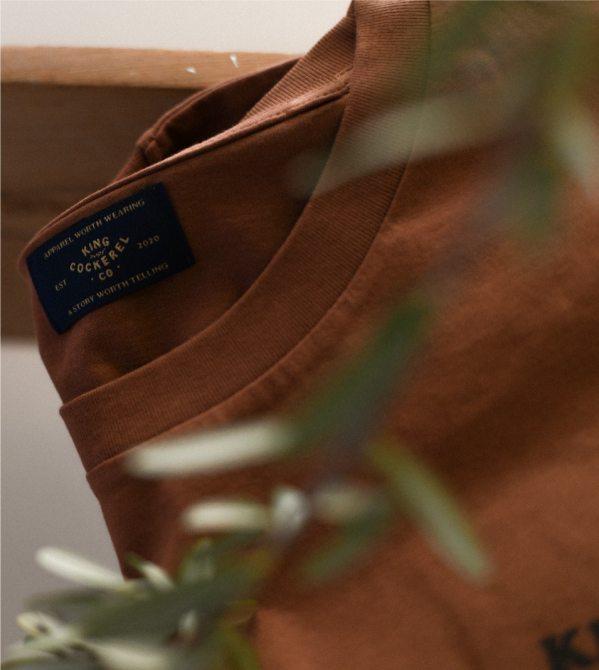 Close up of King cockerel T-shirt label