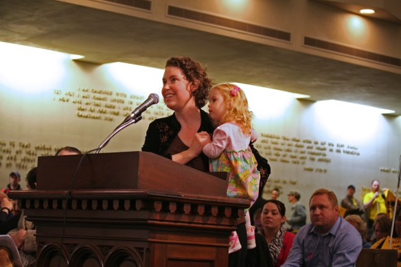 Celeste Gilman and her daughter speak in support of transit to state leaders at a hearing in Seattle Oct. 14, 2013.