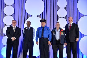 Metro's Al Ramey and two other longtime safe bus operators, May 4 at the APTA Bus & Paratransit Conference in Kansas City. From left: APTA Chair Peter Varga; Ralph Spain, Maryland Transit Administration, 42 years; Jess Quintero, VIA Metropolitan Transit, 48 years; Al Ramey, King County Metro Transit, 51 years; and APTA President & CEO Michael Melaniphy - Photo by Steve Puppe.