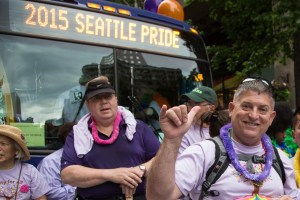 Pride parade photo with bus and celebrants