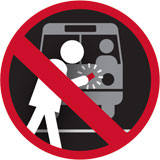 Graphic with red circle and line warning riders to not look down at their phone while walking in traffic