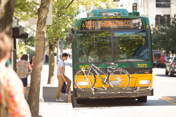 Route 355 bus picks up passenger