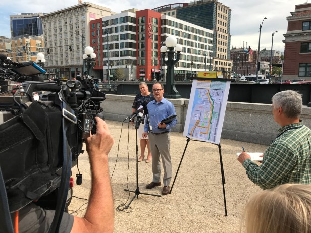 Metro Managing Director of Service Development Bill Bryant and SDOT Director of Downtown Mobility Heather Marx speaking at media availability on service revision for First Avenue to Fourth Avenue South
