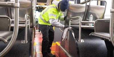 tyler goodwin cleans the inside of a Metro bus March 2, 2020