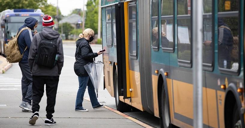 Passengers board a Metro bus in south King County