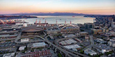 Scenic aerial photo of downtown Seattle, the Puget Sound, and Olympic Mountains