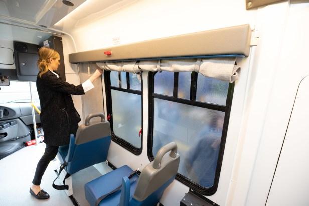 AN employee adjusts curtains inside a Metro lactation shuttle