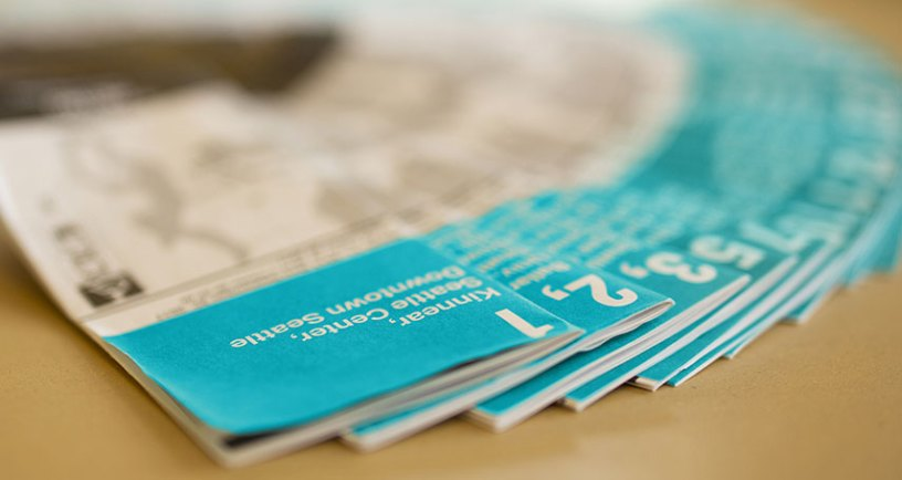 blue transit timetables on a tabletop