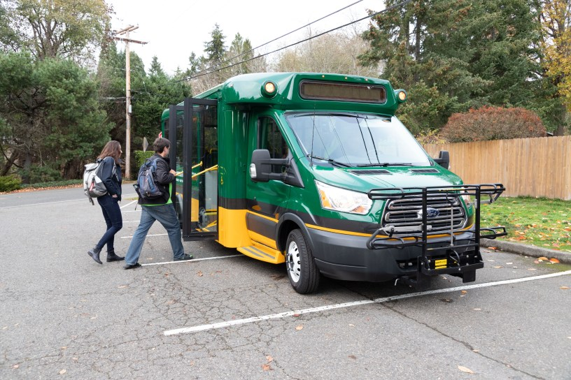 Riders board a Community Ride vehicle