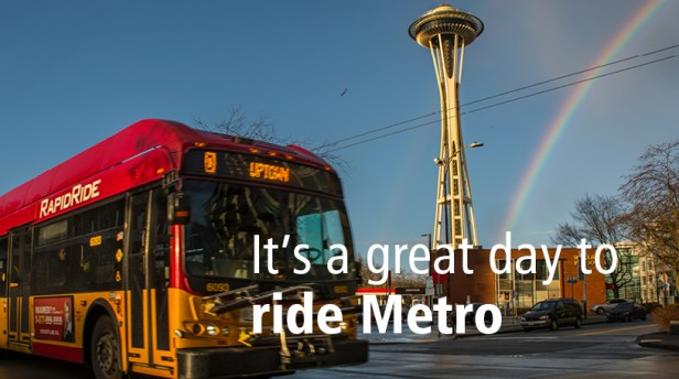 RapidRide bus with Space Needle and rainbow in background