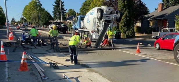 Paving the northbound lanes of 26th Avenue SW