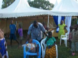 Bro.-Moses-praying-for-disabled-orphans