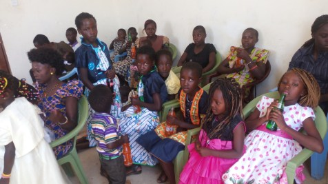 My daugther Rebecca and Precious with orphans drinking sodas after eating