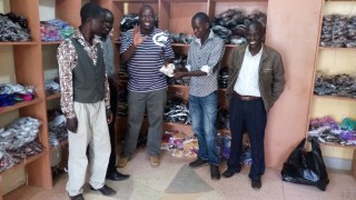 Pastor Moses and the team paying for shoes and sandals at the shoes shop