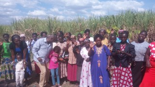 Pastor Moses holding Rebbecca and my wife right holding Precious with celebrating with widows for the clothes