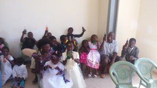 Pastor Moses with brother Alext joining orphans in drinking a soda
