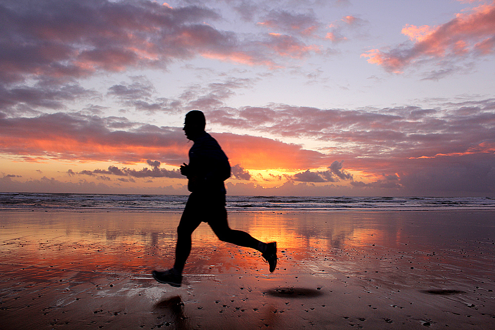 running at sunset photo