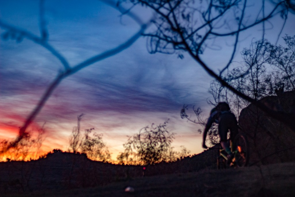 Kingdom Enduro - Christian Schmidt dropping into the donga at last light on freefall trail photo: Darol Howes