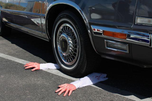 Arms under car halloween joke