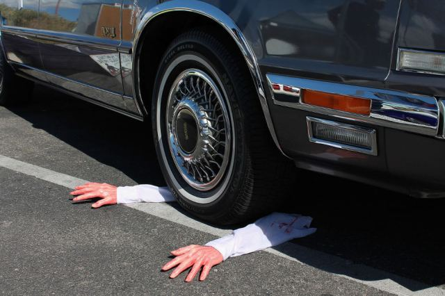 Arms under car halloween joke