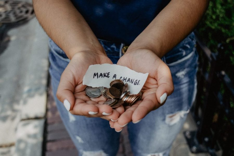 woman holding coins in her hands