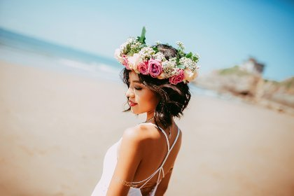 woman with a wreath of flowers on her head depicting affirmation for unique and amazing