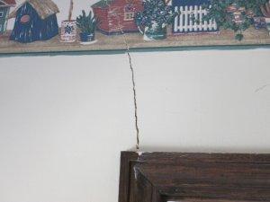 cracks indicate sinking footing