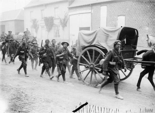 Men of the 10th Battalion, East Yorkshire Regiment (Hull Commercials) marching to the trenches; near Doullens, 28th June 1916.