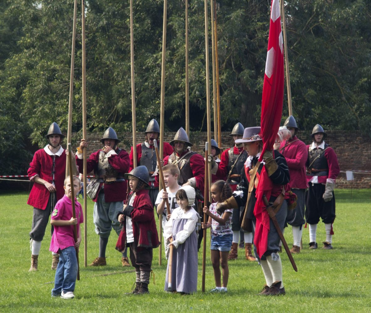 English Civil War reenactors ready with pikes show kids how to use them