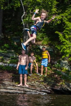 ropeswing jumping water lake woods mountains sleepaway camp boys