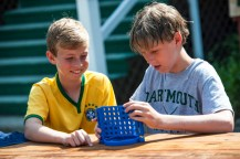 boys playing board games at a summer camp
