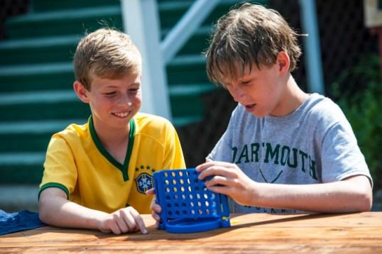 boys playing board games at a summer camp