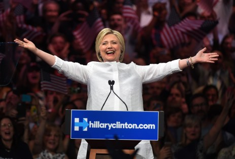 """Democratic presidential candidate Hillary Clinton acknowledges celebratory cheers from the crowd during her primary night event at the Duggal Greenhouse, Brooklyn Navy Yard, June 7, 2016 in New York. Hillary Clinton hailed a historical """"milestone"""" for women as she claimed victory over rival Bernie Sanders in the Democratic White House nomination race. """"Thanks to you, we've reached a milestone,"""" she told cheering supporters at a rally in New York. """"The first time in our nation's history that a woman will be a major party's nominee."""" / AFP / TIMOTHY A. CLARY (Photo credit should read TIMOTHY A. CLARY/AFP/Getty Images)"""