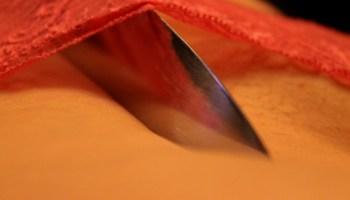 knife digging into flesh cutting off panties