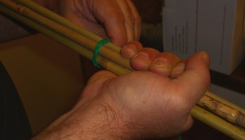 Man's hands making homemade cane