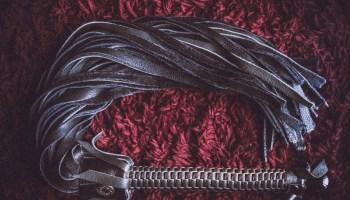 Black leather flogger for flogging