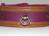 The brown sections of this wonderful collar are a printed vinyl. However the beautiful purple strap is 100% cow leather.