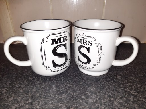 """White """"Mr S"""" and """"Mrs S"""" mugs on a granite effect countertop."""