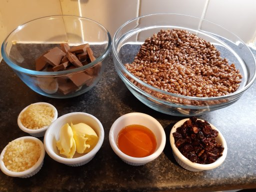 Ingredients laid out in bowls on a granite effect worktop - Bat Bites recipe.