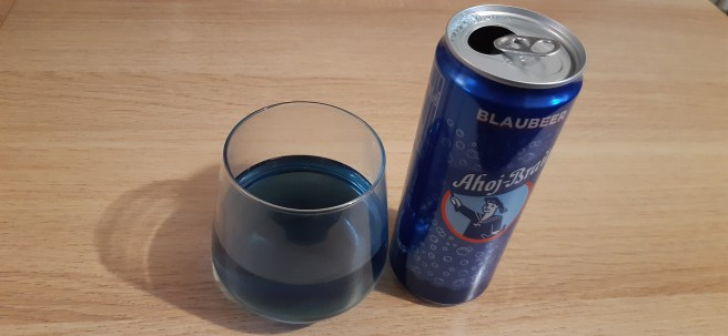 German Blaubeer with glass on wooden table