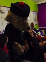 The children of Kinloss Primary School welcome Hero bear