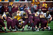 Morris darts through the Gopher line and tackles the QB for a loss