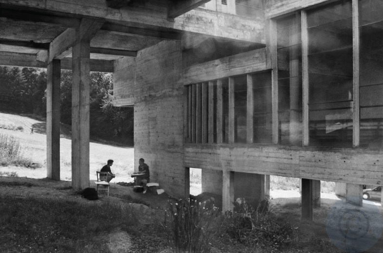 Print: A lesson in modernist transparency in architecture - American teacher and student at a seminar work at La Tourette, 1993 Mobility on site and in the buildings, vertical light, scaling of volumes and skins of facades, pillars design Le Corbusier architect - Couvent de la Tourette France 1953-1961 © Prosper Jerominus 1993, 2021