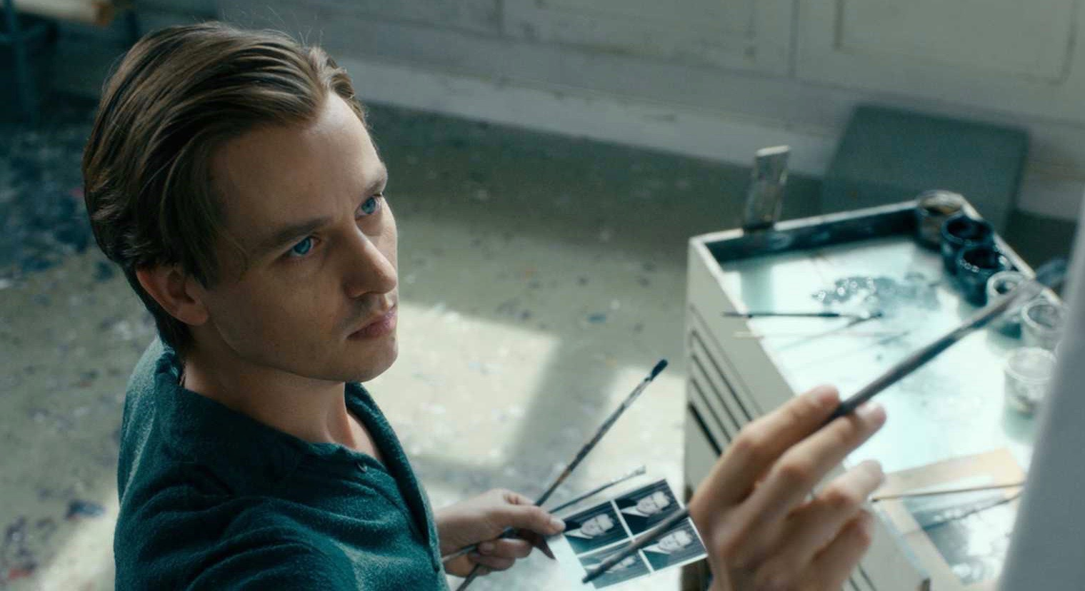 Young artist painting in Never Look Away film.