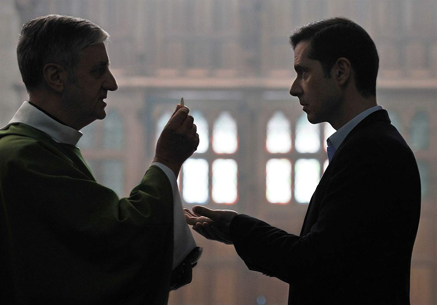 By the Grace of God, a priest and man talking in the church