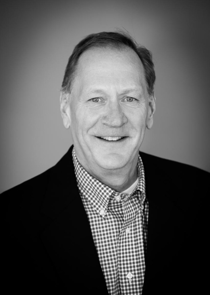 male corporate headshot in black and white