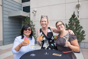 ladies cheers at summer chefs table, networking photographer, event coverage, conference photographer, outdoor event space, party photographer, Hyatt regency Denver