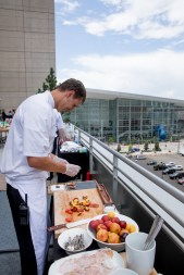 chefs paling food at event, event catering staff event photographer, chefs at event, executive chef, paling lunch for group, Colorado Convention center, Denver Big Blue Bear, CCC, Big Blue bear, event food prep, event photographer