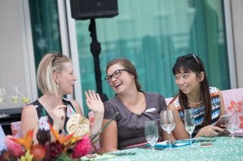 3 women laughing, women enjoying summer Chef's table at Hyatt Regency Denver at Colorado convention center, patio reception, wine tasting, downtown Denver